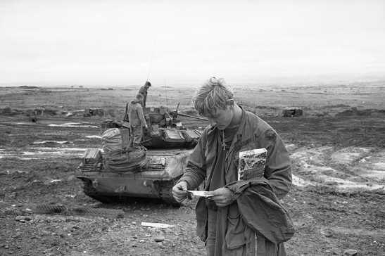 soldier reading a letter